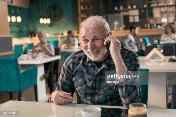 Happy senior man talking on cell phone
