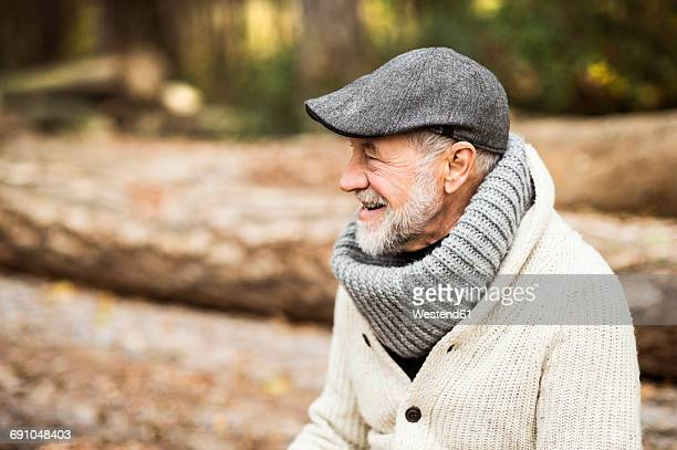 Happy senior man wearing cap and polo neck