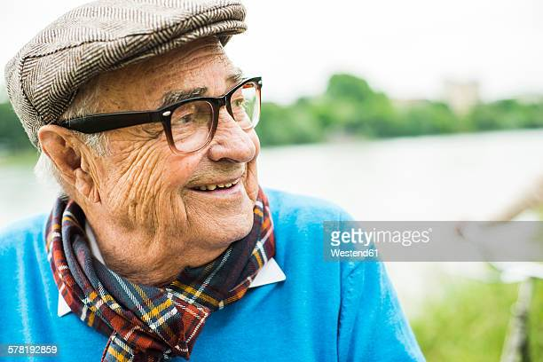 Happy senior man with glasses and cap