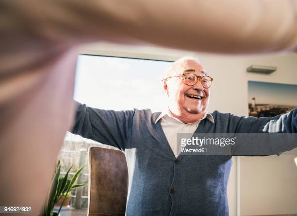 Happy senior man with outstretched arms