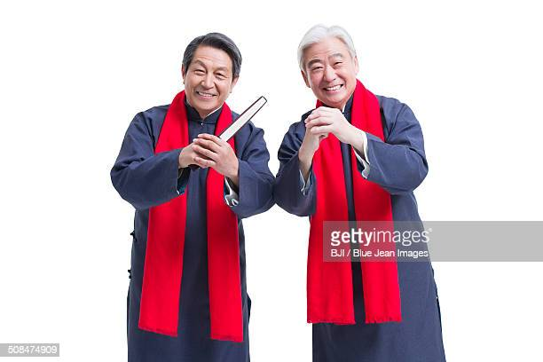 Happy senior men greeting for Chinese New Year