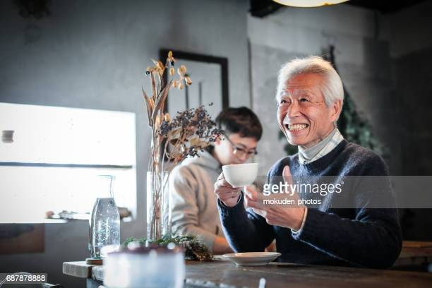 happy senior owner relaxing at the cafe - 経済 stock pictures, royalty-free photos & images