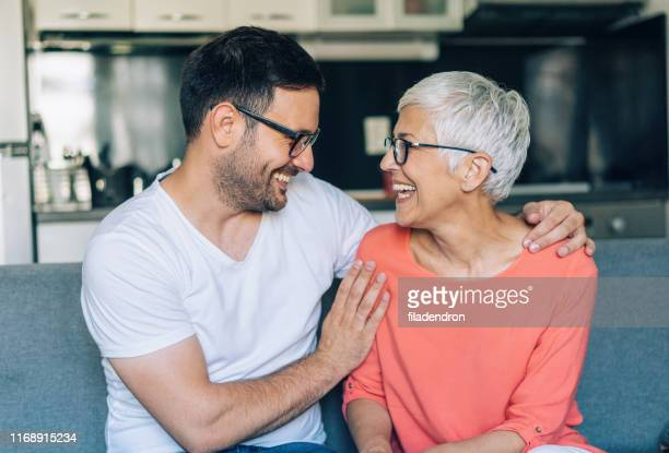 happy senior woman and her son - respect stock pictures, royalty-free photos & images