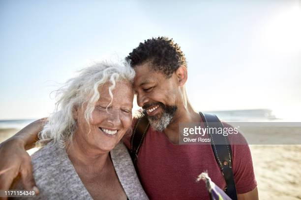 happy senior woman and mature man embracing - love stock pictures, royalty-free photos & images