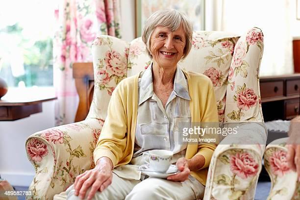 Happy senior woman in nursing home