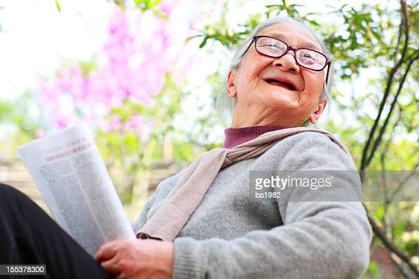 happy senior woman in the garden