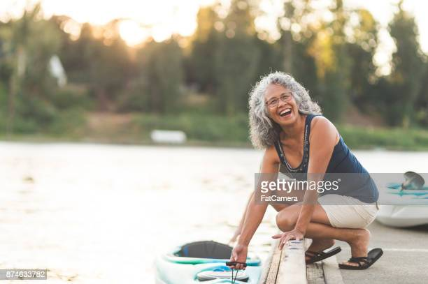 happy senior woman on a kayaking trip - pacific islander stock pictures, royalty-free photos & images