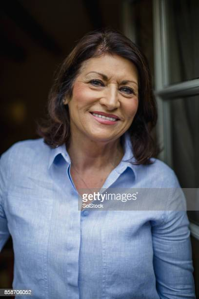 happy senior woman - blue blouse stock pictures, royalty-free photos & images