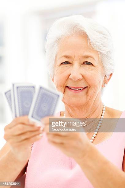 Happy Senior Woman Playing Cards