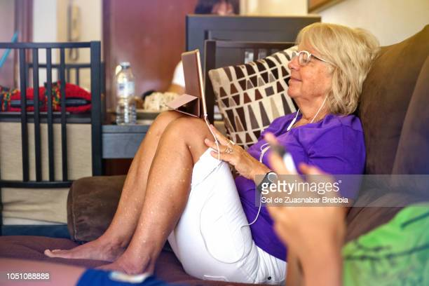 happy senior woman using a digital tablet - candid forum stock pictures, royalty-free photos & images