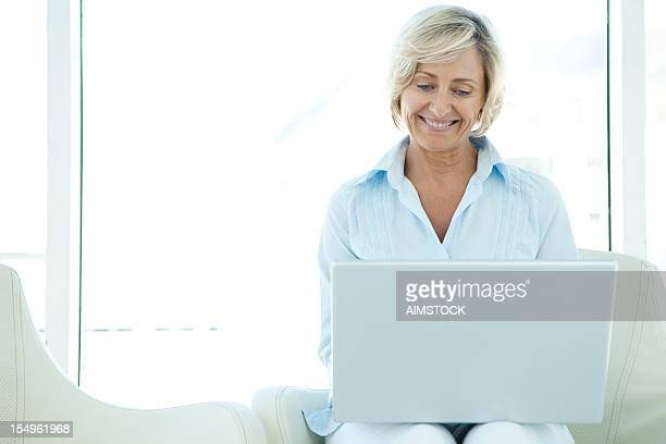 Happy Senior Woman using laptop