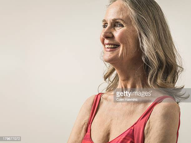 happy senior woman wearing sports top - beautiful people stock pictures, royalty-free photos & images