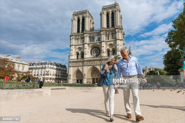happy seniors in paris, having a wonderful vacation - tourism stock pictures, royalty-free photos & images