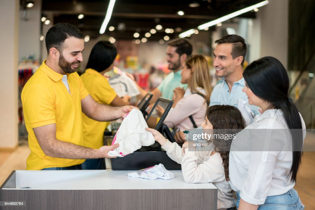 14d3b9892 Happy Shopping Family Paying At A Clothing Store Stock Photo - Getty ...