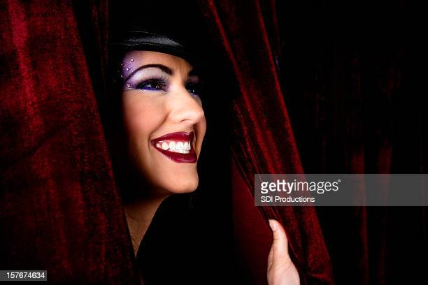 Happy Show Girl Peaking Through Curtain at Fans