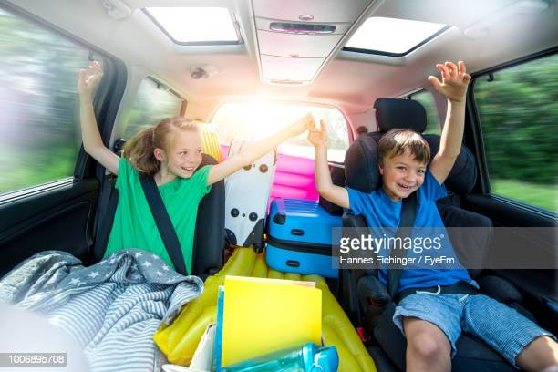 happy siblings sitting in car - family inside car stock photos and pictures