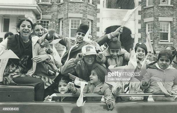 Happy Sikhs celebrate holy day Carloads of Sikhs including many children waving bright yellow flags joined in the downtown parade yesterday marking...