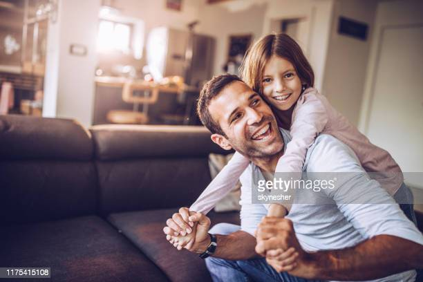 happy single father having fun with his small daughter at home. - daughter stock pictures, royalty-free photos & images