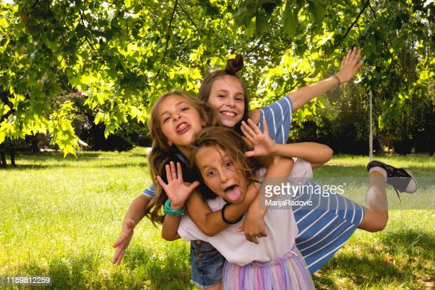 happy sisters having fun in the park - in the park day 3 imagens e fotografias de stock