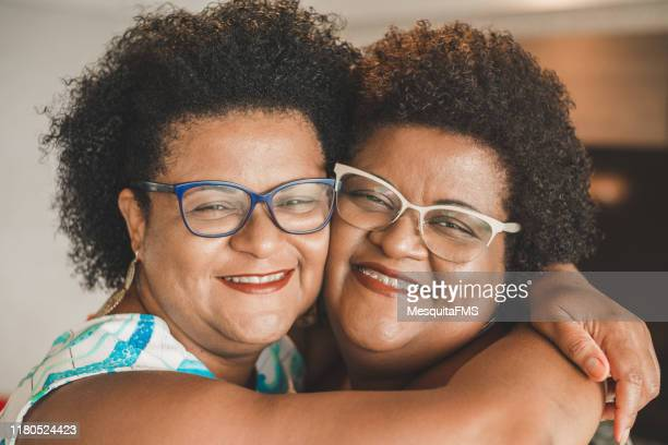 happy sisters - sister stock pictures, royalty-free photos & images