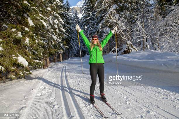 happy skier posing for photo - nordic skiing event stock pictures, royalty-free photos & images