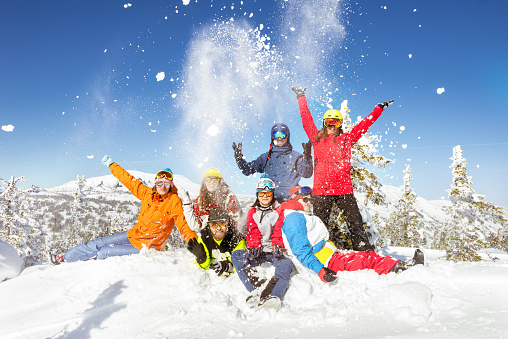 Happy skiers and snowboarders winter vacations 1035117954