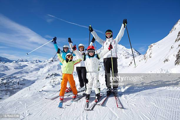 happy skiing group in mountains