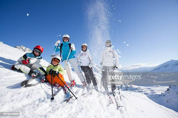 happy skiing group - wintersport stockfoto's en -beelden