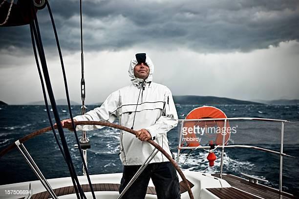 Happy skipper driving sailboat