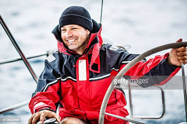 happy skipper on sailboat - sailor stock pictures, royalty-free photos & images