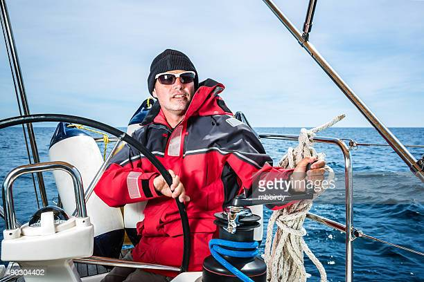 happy skipper on sailboat - sailing team stock pictures, royalty-free photos & images