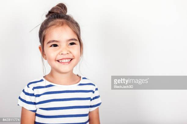 happy small girl - youthful stock pictures, royalty-free photos & images