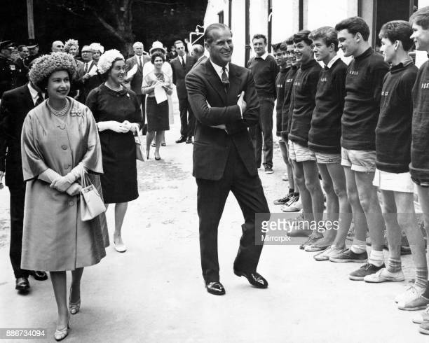 A happy smile from the Queen and the Duke for some of the boys at the Outward Bound School for Boys at Aberdovey 10th August 1963