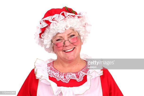 glückliches lächeln - weihnachtsfrau stock-fotos und bilder