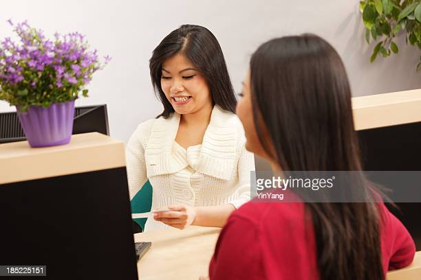 Happy Smiling Asian Bank Teller Serving Customer Hz