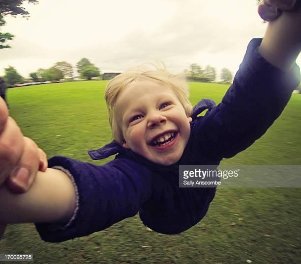 Happy smiling child having fun in the park