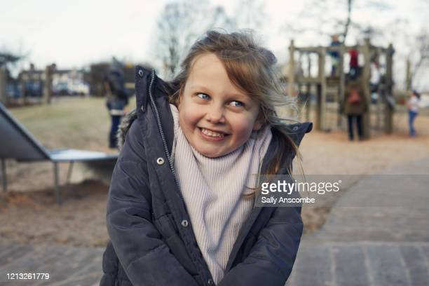 happy smiling child in a park - emotion stock pictures, royalty-free photos & images