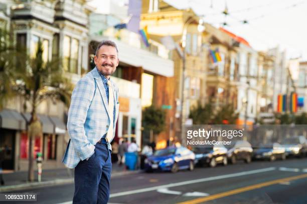happy smiling colorful senior man portrait on castro street in san francisco - castro district stock pictures, royalty-free photos & images