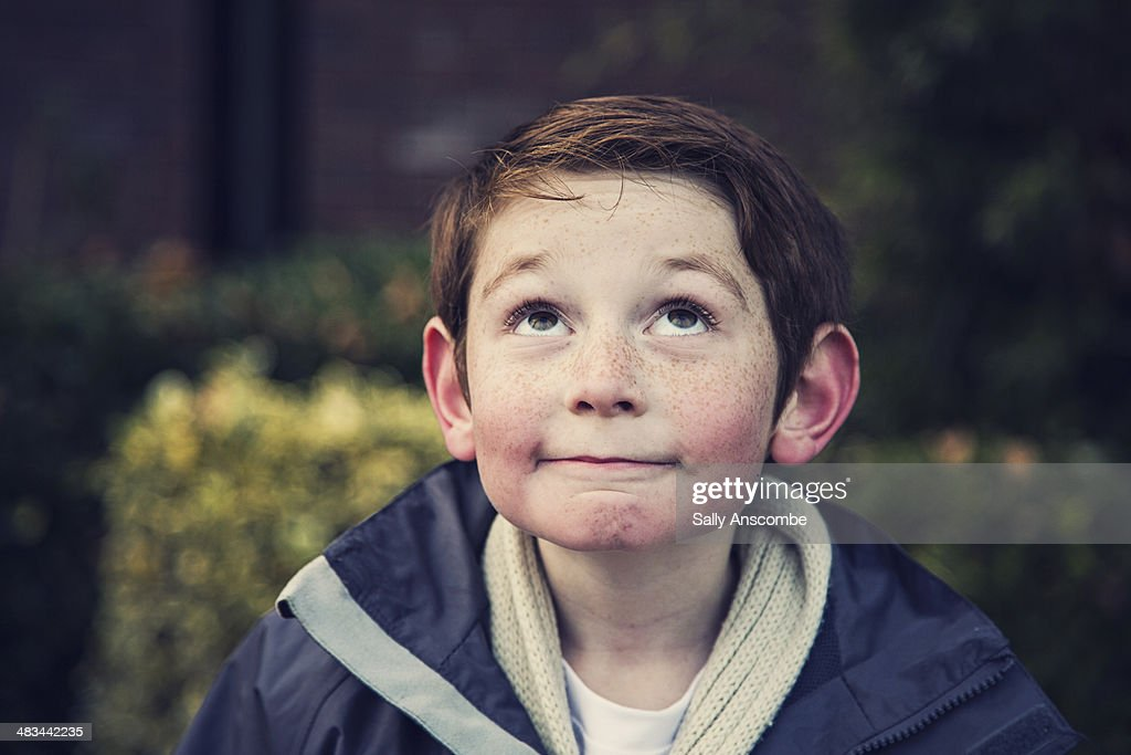 Happy smiling little boy looking up : Stock Photo