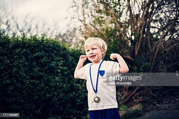 happy smiling little boy with a medal - medal stock pictures, royalty-free photos & images