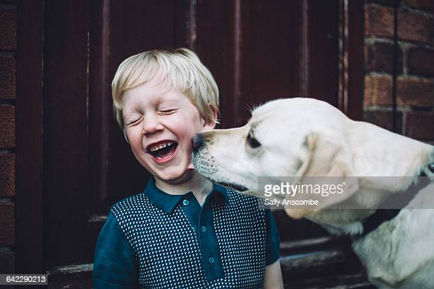 happy smiling little boy with pet dog - real people stock pictures, royalty-free photos & images