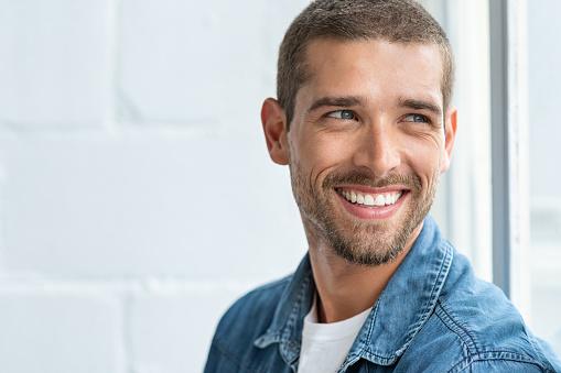 Happy smiling man looking away 1158245623