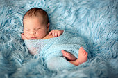 http://www.istockphoto.com/photo/happy-smiling-newborn-baby-in-wrap-sleeping-happily-gm836180308-135991331