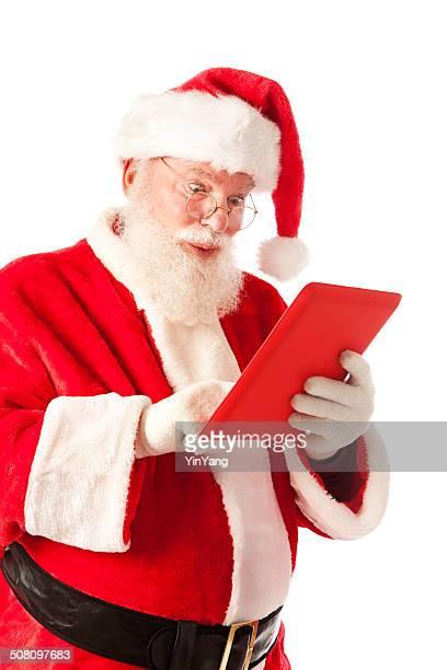 Feliz sorridente Santa Claus usando Tablet Digital computador Vertical
