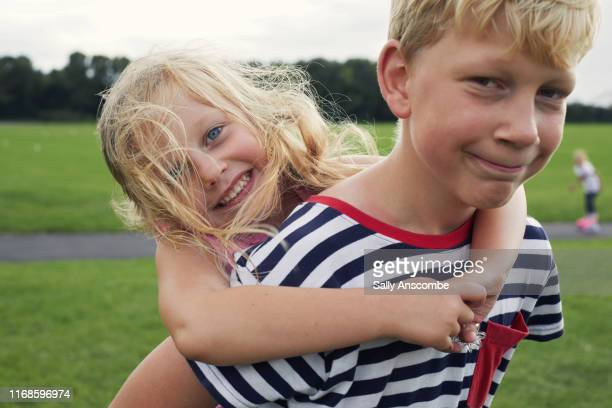 happy smiling siblings together - southport england stock pictures, royalty-free photos & images