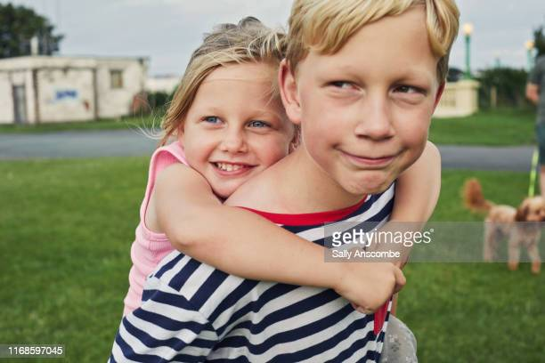 happy smiling siblings together - sally anscombe stock pictures, royalty-free photos & images
