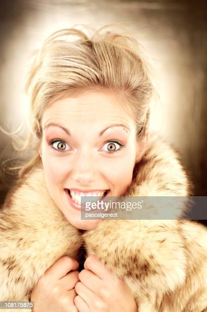 happy smiling woman wearing fur coat - hazel eyes stock pictures, royalty-free photos & images
