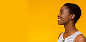 Happy smiling young african american woman profile portrait
