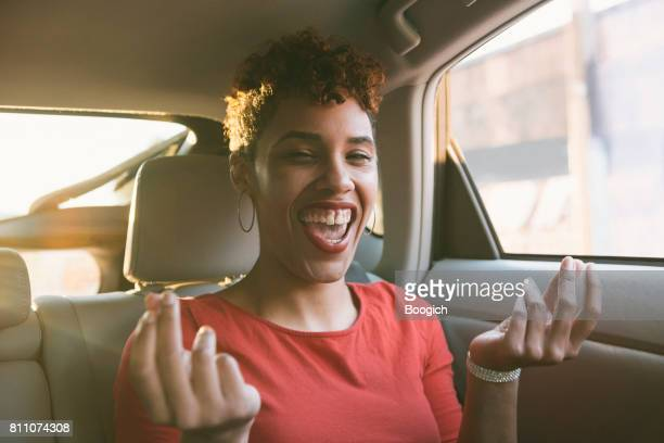 Happy Smiling Young Millennial Mixed Black Woman Singing in Car