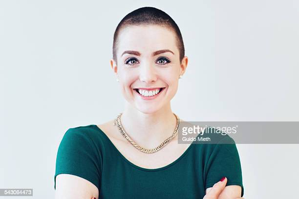 happy smiling young woman. - shaved head stock pictures, royalty-free photos & images